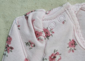 Detail of clothing stitched onto the reverse of the pouch
